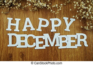Happy December alphabet letters on wooden background