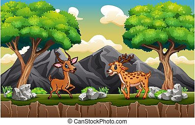 Happy deers playing at the hill landscape