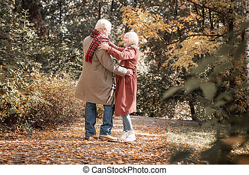 Happy delighted couple dancing in the forest