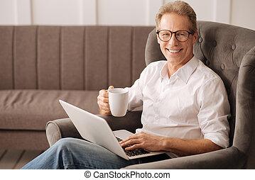 Happy delighted man enjoying his work