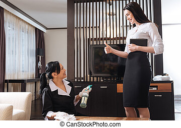 Happy delighted manager being satisfied with her maids work...
