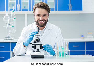 Happy delighted scientist smiling