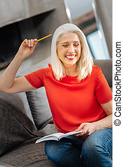Happy delighted woman having an idea