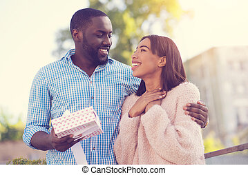 Happy delighted woman looking at her boyfriend