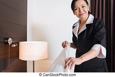 Happy delighted woman working as a hotel maid - Service...