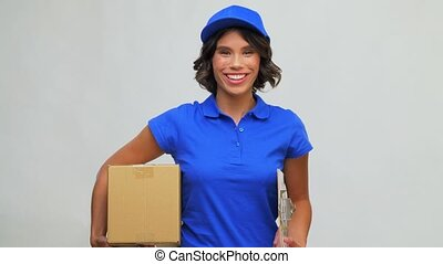 happy delivery girl with parcel box and clipboard - mail ...