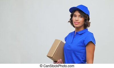 happy delivery girl with parcel box in blue - mail service ...