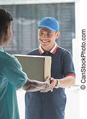 happy delivery man with package