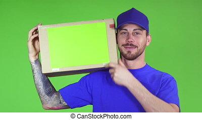 Happy deliveryman smiling putting cardboard box with...