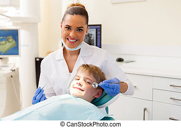 dentist consulting little patient in office