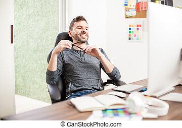 Happy designer taking a break at work