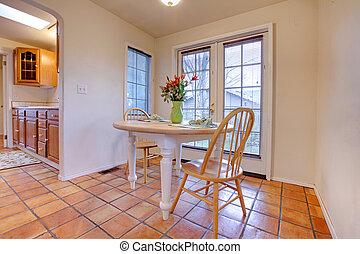 Happy dining room with orange tile floor