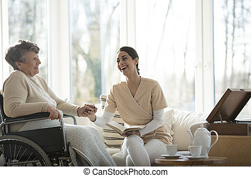 Happy disabled elderly woman