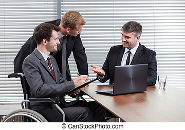 Happy disabled man during business meeting, horizontal