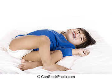 Happy disabled toddler boy with cerebral palsy lying down