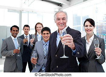 Happy diverse business group toasting with Champagne to...