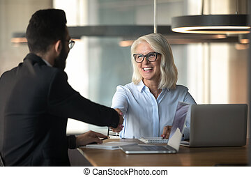 Happy diverse businesspeople handshake greeting at office meeting