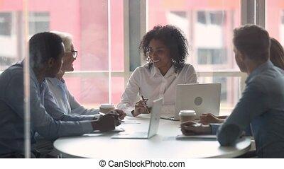 Happy diverse businesswomen handshaking at international...