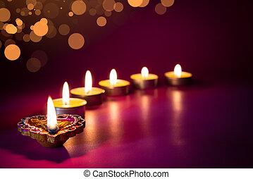 Happy Diwali - Clay Diya lamps lit during Dipavali, Hindu...