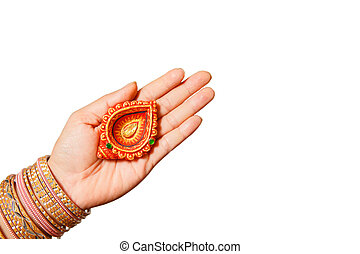Happy Diwali - Woman hands with henna holding lit candle isolated on white background. Hindu festival of lights celebration. Copy space for text.