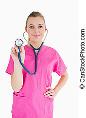 Happy doctor holding a stethoscope