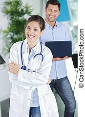 happy doctor in her office
