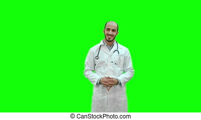 Happy doctor smiling at the camera on a Green Screen, Chroma Key.
