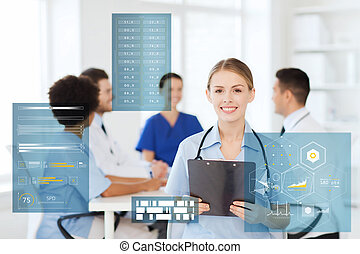 happy doctor with clipboard at hospital