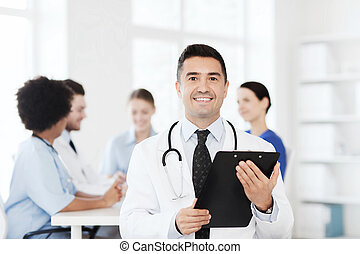 happy doctor with clipboard over medical team