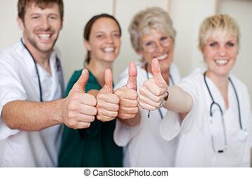 Happy Doctors Team Showing Thumbs Up