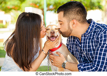 Happy dog getting lots of kisses