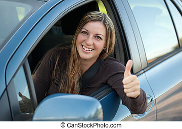 Happy driver - A happy driver leaning out of the window and...