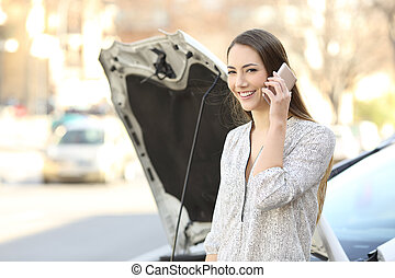 Happy driver calling insurance and looking at you