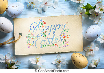 Happy Easter Background; Spring flowers and easter eggs -...