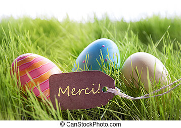 Happy Easter Background With Colorful Eggs And Label With French Text Merci