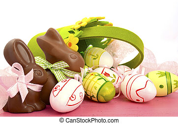 Happy Easter chocolate bunny rabbits with basket of pink,...