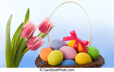 Happy Easter! - Composition of tulip bouquet with basket of...
