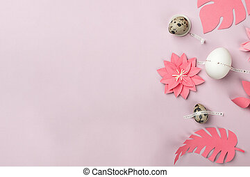 Happy Easter concept. Flat lay. Minimal concept. Top view. Set of eggs and coral origami papercraft flowers on pink background with copy space