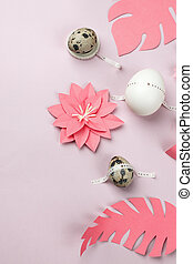 Happy Easter concept. Flat lay. Minimal concept. Top view. Set of eggs and coral origami papercraft flowers on pink background