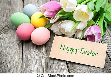 Happy Easter - Easter eggs and tulips with a tag on wooden ...