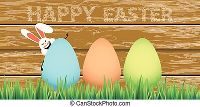 Happy easter eggs in grass with rabbit