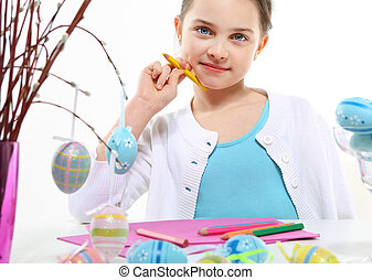 Happy easter eggs - Cheerful little girl painting Easter...