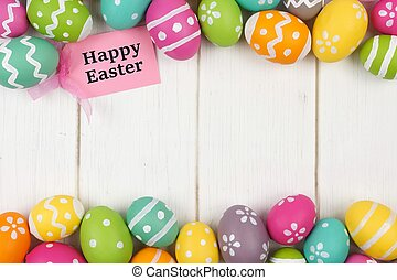 Happy Easter gift tag with colorful Easter egg double border against a white wood background