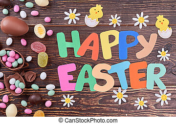 Happy Easter lettering and candies. Felt chicken and flower...