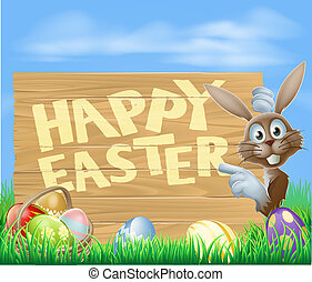 Happy Easter sign with Easter bunny pointing at the wooden...