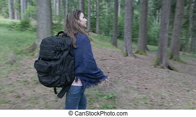 Happy ecologist woman trekking on mountain forest exploring...
