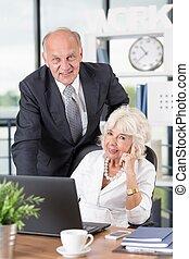 Happy elder business partners