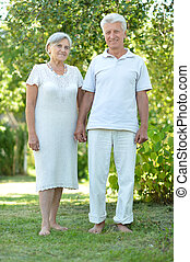 Happy elder couple in the late spring outside