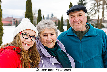 Happy elderly couple and young caregiver