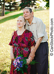Happy elderly couple at nature. Happy old people